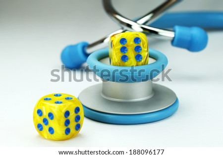 Health, health care, medical tool, dice, red dice, gamble, two dice, medical, rolled dice, yellow dice, blue spots, conceptual, stethoscope, light blue stethoscope, - stock photo