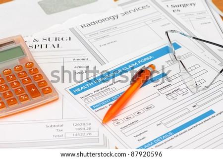 Health Insurance Claim with Surgery Bills - stock photo