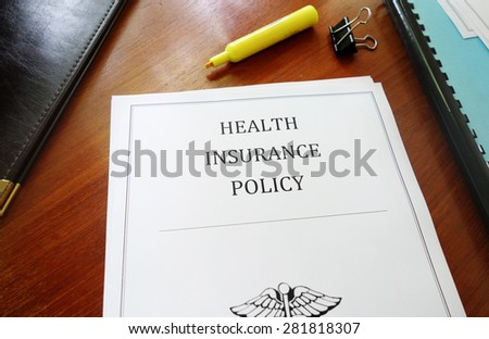 Health Insurance Policy on an office desk                                - stock photo