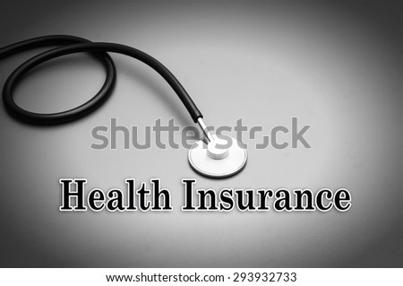 Health insurance text with stethoscope - stock photo