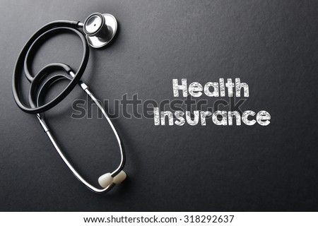 Health insurance word with stethoscope - health concept. Medical conceptual - stock photo