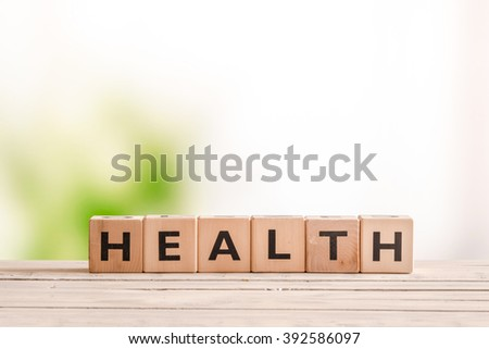 Health sign made of wood on a natural desk - stock photo