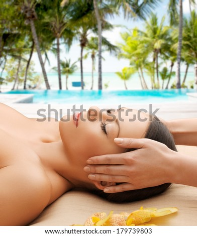 health, spa and beauty concept - calm beautiful woman in massage salon - stock photo