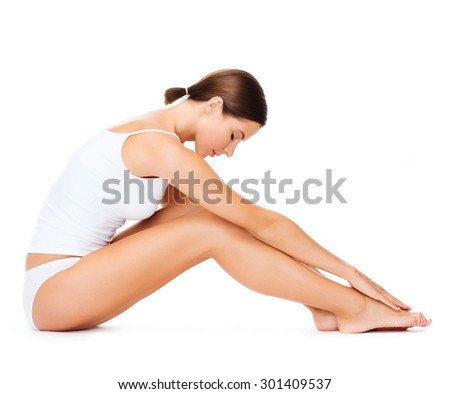 health, sport and beauty concept - sporty woman in cotton underwear doing exercises - stock photo
