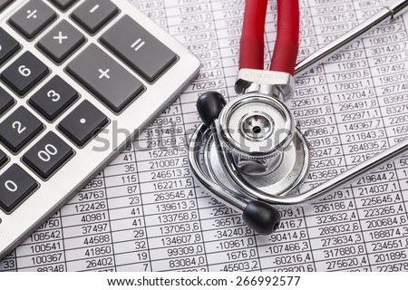 Health. Stethoscope and calculator on document with digits - stock photo