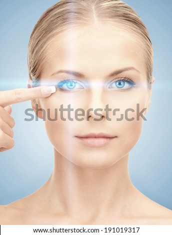 health, vision, sight, future technology concept - woman eye with laser correction frame - stock photo