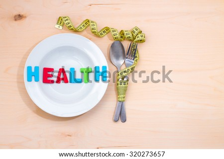 Health word on the plate. A low-calorie diet for weight loss - stock photo