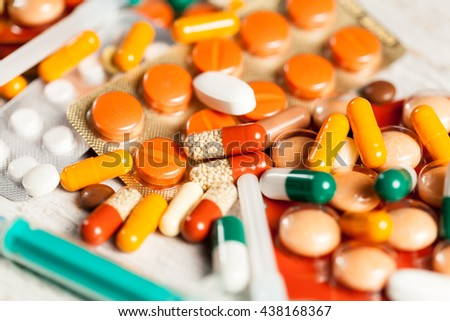 Healthcare and desise. Pills and drugs on table in close up photo - stock photo