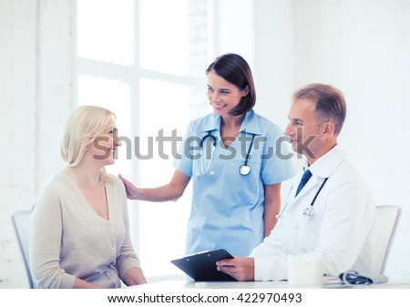 healthcare and medical concept - doctor and nurse with patient in hospital - stock photo
