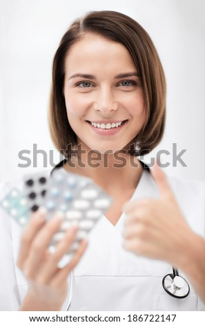 healthcare and medical concept - doctor with blister packs of pills - stock photo