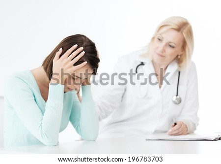 healthcare and medical concept - doctor with patient in hospital - stock photo