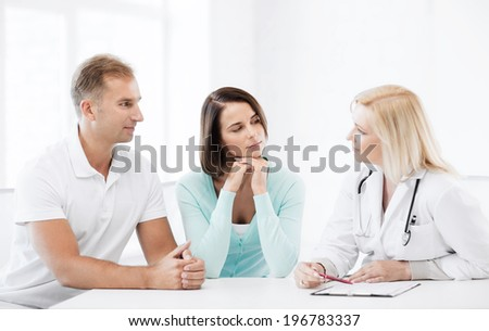 healthcare and medical concept - doctor with patients in cabinet - stock photo