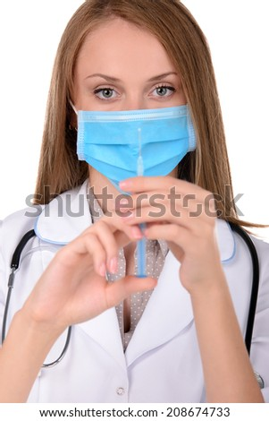 Healthcare and medical concept - female doctor or nurse in medical mask holding syringe with injection - stock photo