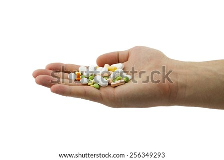 Healthcare and medical concept. Heap of different pills, tablets and capsules in the man hand isolated on white background - stock photo