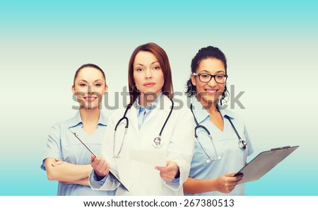 healthcare and medicine concept - calm female doctor and nurses with clipboard and stethoscope giving prescription - stock photo