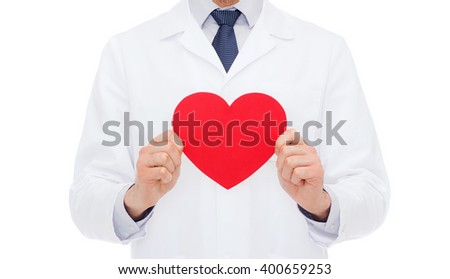 healthcare and medicine concept - male doctor with red heart - stock photo
