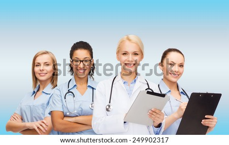 healthcare and medicine concept - smiling female doctor and nurses with tablet pc - stock photo