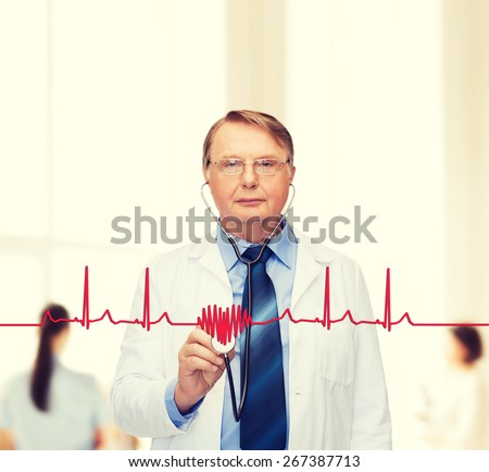 healthcare and medicine concept - smiling standing doctor in eyeglasses or professor in eyeglasses with stethoscope - stock photo