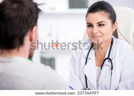 Healthcare and medicine concept. Young female doctor with and patient in hospital. - stock photo