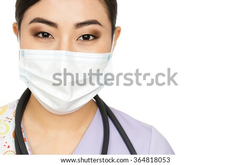 Healthcare assistance. Cropped closeup portrait of an Asian female doctor wearing surgical mask isolated on white - stock photo