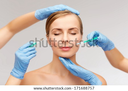 healthcare, beauty and medicine concept - beautiful woman face with closed eyes and beautician hands with syringe - stock photo