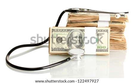 Healthcare cost concept: stethoscope and dollars isolated on white - stock photo