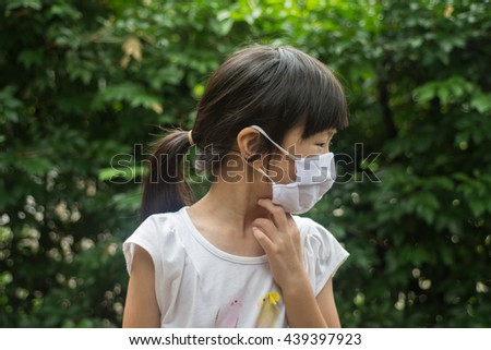Healthcare - girl wearing a protective mask  - stock photo
