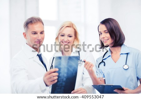 healthcare, medical and radiology concept - doctors looking at x-ray - stock photo
