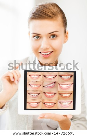 healthcare, medical and stomatology - female doctor with tablet pc and smiles - stock photo