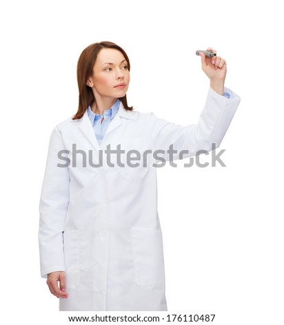 healthcare, medical and technology concept - young female doctor writing something in the air - stock photo