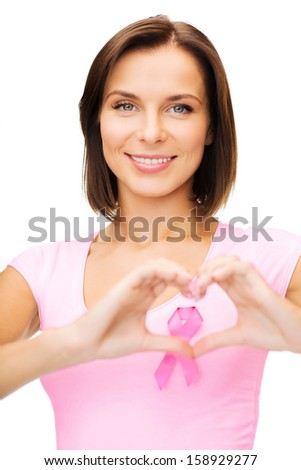 healthcare, medicine and breast cancer concept - woman with pink cancer ribbon - stock photo