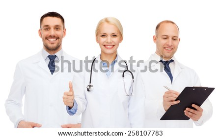 healthcare, people, gesture and medicine concept - group of doctors with stethoscope and clipboard showing thumbs up over white background - stock photo