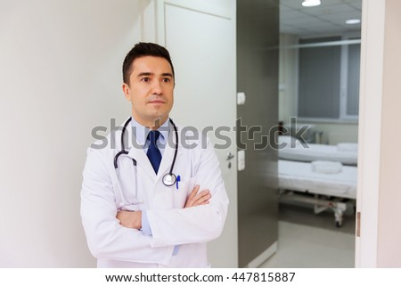 healthcare, profession, people and medicine concept - male doctor in white coat with stethoscope at hospital - stock photo