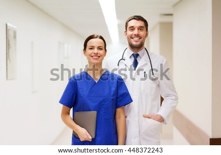 healthcare, profession, people and medicine concept - smiling doctor in white coat and nurse with tablet pc computer at hospital - stock photo