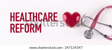 HEALTHCARE REFORM concept with stethoscope and heart shape - stock photo