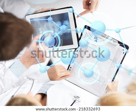 healthcare, technology, medicine and people concept - group of doctors with tablet pc, clipboard and molecular projection - stock photo