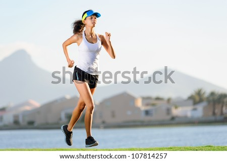 Healthy active female runner training outdoors for marathon. fitness woman lifestyle - stock photo