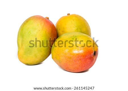 Healthy and colorful yellow red and orange mangos still life isolated on white background cutout - stock photo