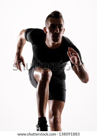 Healthy and fitness man running on white background. - stock photo