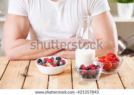Healthy and nutritious organic yogurt with cereal and fresh raw berries - stock photo