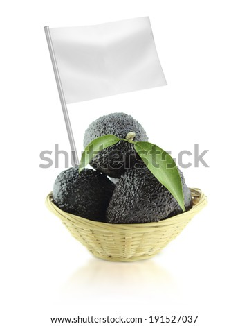 Healthy and organic food concept. Fresh Avocados with leaves on a Dish of straw with flag showing the benefits or the price of fruits. - stock photo