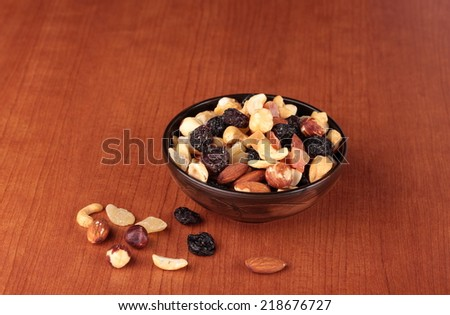 Healthy and tasty snack. Nuts and dried fruits - stock photo