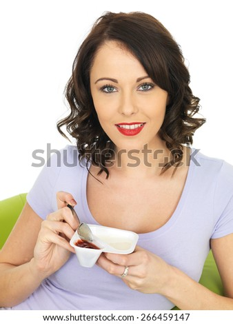 Healthy Attractive Young Woman Eating a Yogurt - stock photo