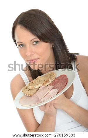 Healthy Attractive Young Woman Holding a Typical Norwegian Style Cold Buffet Breakfast of Meats and Bread - stock photo