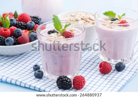 healthy berry smoothies with oatmeal in a glass, close-up - stock photo