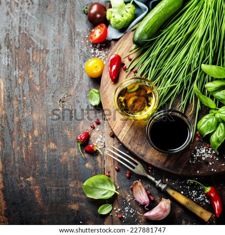 Healthy Bio Vegetables and spices on a Wooden Background - stock photo