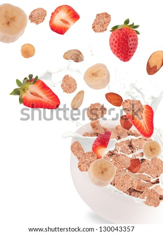 Healthy bowl with flying cereals and fruit, isolated on white background - stock photo