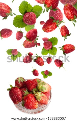 Healthy bowl with flying fresh strawberries, isolated on white background - stock photo