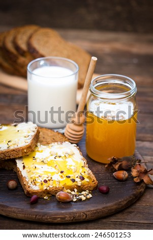 Healthy breakfast - bread, butter and honey - stock photo