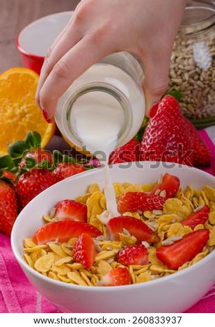 Healthy breakfast cornflakes and strawberries - water milk, bio healthy, eat clean - stock photo